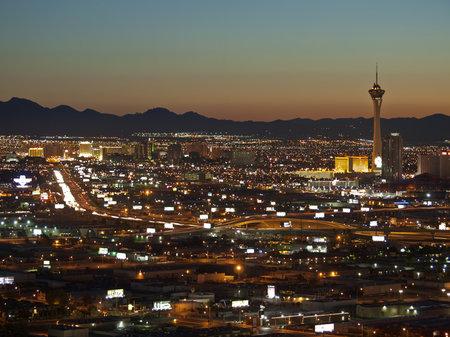 estratosfera: LAS VEGAS NEVADA - SEPTEMBER 13:  Warm sunrise light greets the Stratosphere Tower and downtown building in Las Vegas Nevada on September 13, 2010.