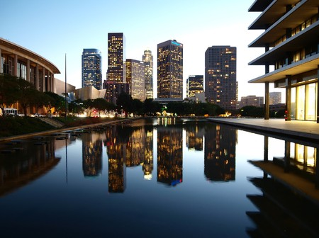 LOS ANGELES CALIFORNIA - OCTOBER 28:  LA DWP architectually renown mid century headquarters and reflecting pond form a backdrop for downtowns modern towers on October 28, 2008 in Downtown Los Angeles.  DWP building was built in 1963 by architect Albert C