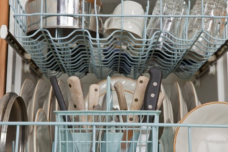 Dishes, pots and silverware rinsed and ready to be washed. Stock Photo - 7906422