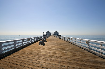 wooden dock: Famous Malibu Pier on a bright sunny California morning.