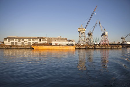 derelict: Derelict industrial waterfront in warm afternoon light.