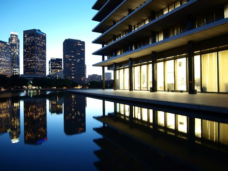 LOS ANGELES, CALIFORNIA - OCTOBER 28: The fountain pond at LA DWP's architecturally renown 1963 headquarters (architect Albert C Martin) reflects modern towers on October 28, 2008 in Los Angeles, California. Stock Photo - 7840315