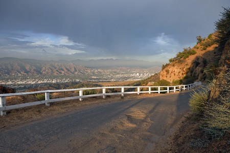 burbank: Famous Mulholland Hwy with thunder clouds and afternoon light.  High in the hills above Los Angeles Burbank and Glendale, California.