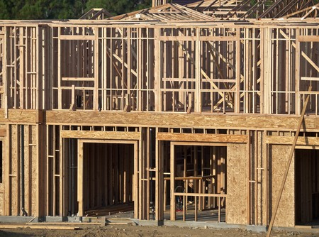 Typical house construction framing in warm early morning light. Stock Photo - 7906462