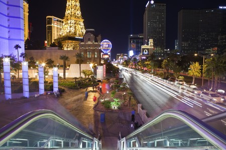 LAS VEGAS, NEVADA - OCTOBER 6:  The Eiffel Tower, Planet Hollywood and other whimsical landmarks entertain tourists on a warm desert night, on October 6, 2010 in Las Vegas, Nevada.