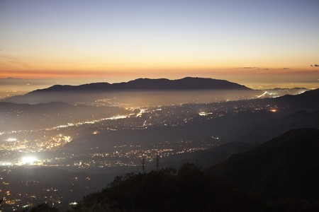 pasadena: Foggy sunset view from Echo Mountain high above Pasadena and Los Angeles, California. Stock Photo