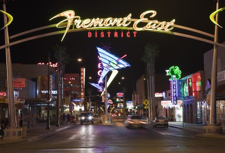 las vegas city: LAS VEGAS, NEVADA - OCTOBER 10:  Restored giant neon signs successfully attract tourists to the newly revitalized Fremont Street East district in downtown, October 10, 2010 in Las Vegas, Nevada. Editorial