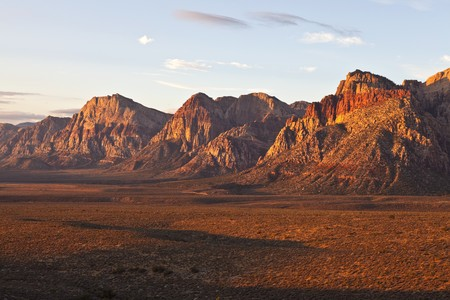 First rays of warm sunrise light in Nevadas Red Rock Conservation Area.