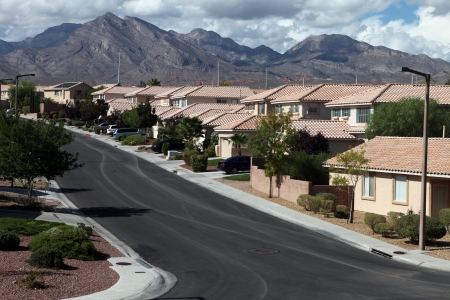 suburbia: Desert homes, mountains and winter storm skies in the Western United States.