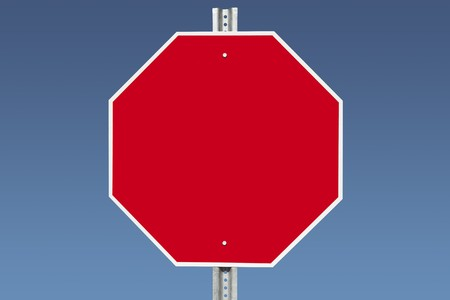 sign post: Blank stop sign on a gradient blue sky.   Stock Photo