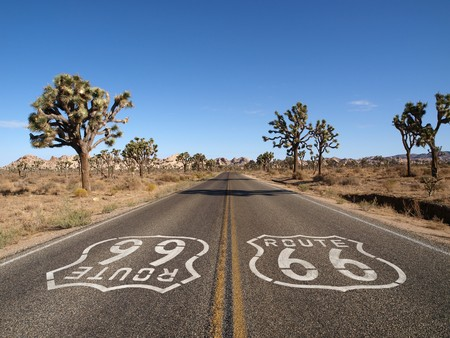 Route 66 with Joshua Trees deep inside Californias Mojave Desert.