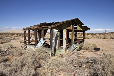 dilapidation: Abandoned cabin in the middle of Californias Mojave Desert.