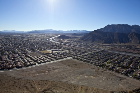 Desert suburban sprawl viewed from Lone Mountain peak towards the Summerlin neighborhood of Las Vegas Nevada. photo
