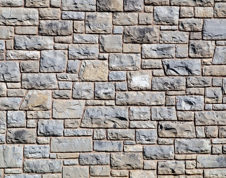 Limestone block wall background texture.