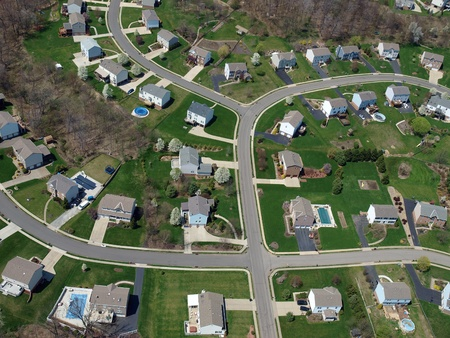 Middle class homes and yards in a modern eastern US bedroom community.