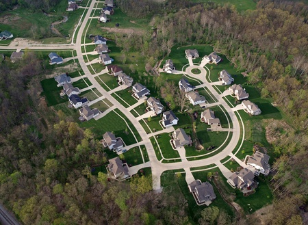 Brand new suburb freshly cut out of a eastern US forest. Stock Photo