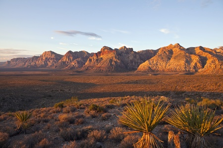 Orange first rays of dawn light on the cliffs of Nevada's Red Rock National Conservation Area. Stock Photo - 8517820