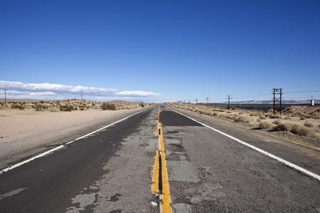 Damaged desert highway in California's harsh Mojave. Stock Photo - 8517822