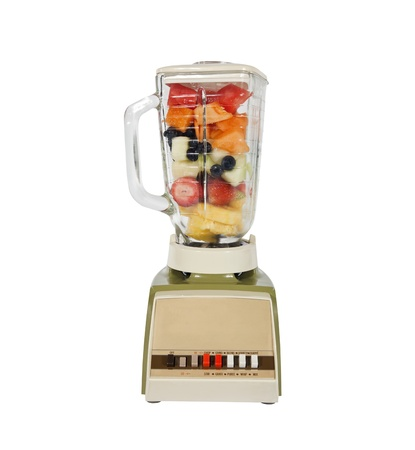Vintage fruit and mellon filled blender ready to rip. photo