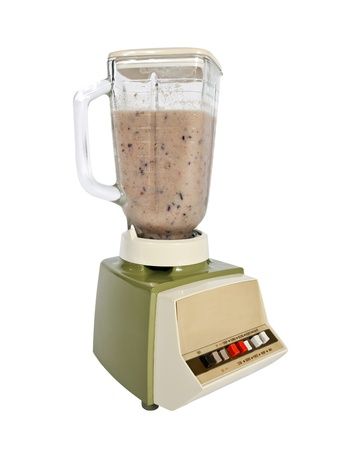 Smoothie freshly made in a vintage 1960s blender. photo
