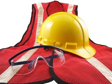Safety equipment, orange vest, glasses and hard hat.  Isolated on white. photo
