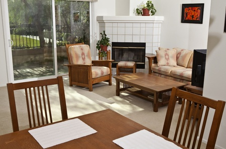 Bright, sunny, California condo living room.  The wall art (photos) are the photographers work and are included in the release.  photo