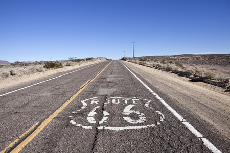 Decayed section of historic Route 66 through Californias vast Mojave desert.