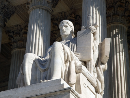 Washington DC, USA - January 10, 2010:  The historic United States Supreme Court Building Statue entitled Authority of Law.