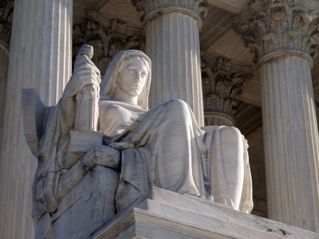 courthouse: Washington DC, USA - January 10, 2010:  Historic United States Supreme Court Building Statue, entitled Contemplation of Justice.