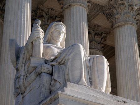"Washington DC, USA - January 10, 2010: Historic United States Supreme Court Building Statue, entitled ""Contemplation of Justice""."