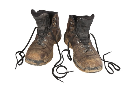 thrashed: Muddy, old, worn, crusty, hiking boots.