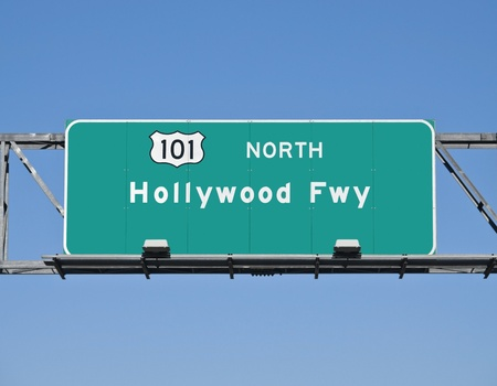Hollywood 101 Freeway overhead sign with clear blue sky. Stock Photo - 8993560