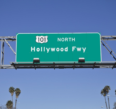 101 Hollywood Freeway sign with tall palm trees.   photo