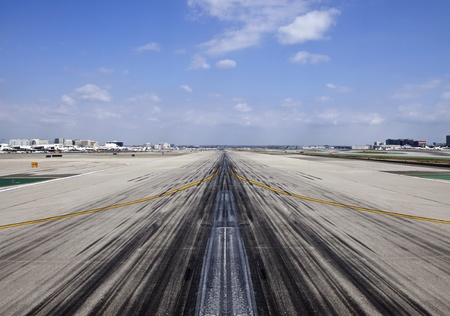 Los Angeles, California, USA - March, 3rd 2011:  Heavy use runway at one of North Americas busiest airports.   Editorial