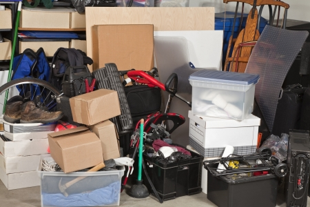 messy: Pile of boxes junk inside a residential garage.