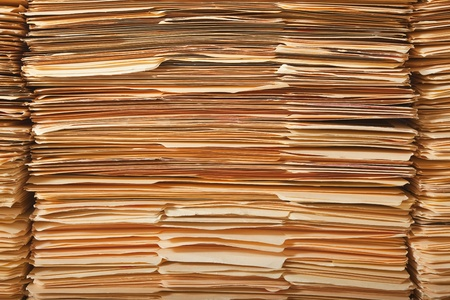 untidy: Tall stack of paper legal file folders. Stock Photo