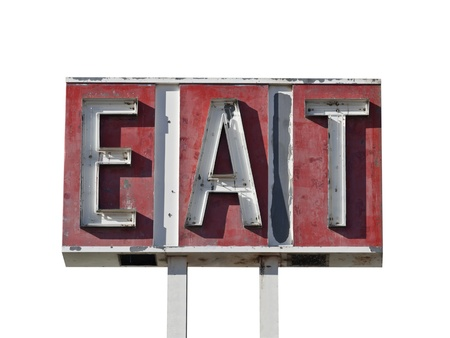 Eat sign ruin along a California desert highway.