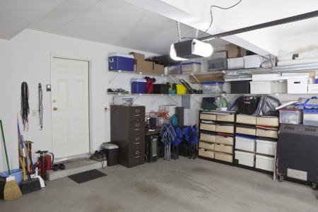 untidy: Simi untidy suburban garage with shelves and storage.