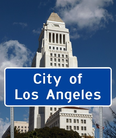Los Angeles iconic City Hall tower with city limit sign foreground. Stock Photo