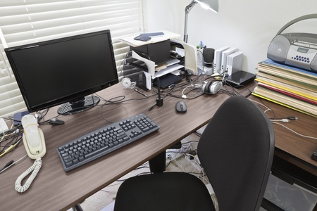 messy: Busy desk in a bright home office. Stock Photo