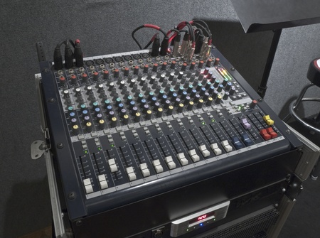 Little music mixing board sitting on its road case. photo