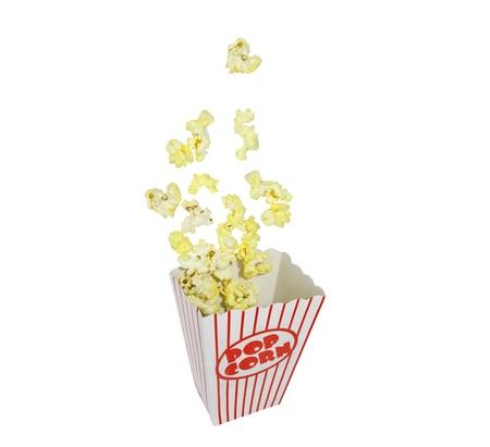 palomitas de maiz: Cuadro de Popcorn estallido aislado en blanco.