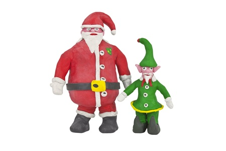 Santa and the senior Elf in charge of production.   Stock Photo - 9887768
