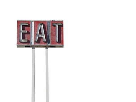 Tall eat sign ruin along a California desert highway. Stock Photo - 10181610