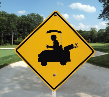 Golf cart crossing sign and sand trap. Stock Photo - 10181613