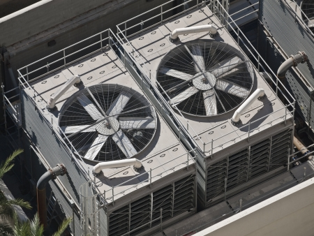 compressor: Typical huge commercial air conditioners in bright desert sun. Stock Photo