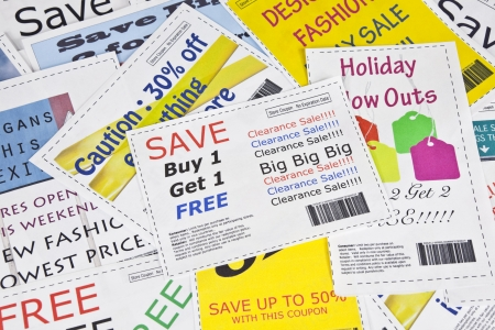 Completely fake fashion coupons.  Fictional bar codes.  All coupons were created by the photographer.  No real ads were used.  Photographs within the coupons are the photographers work and are included in the release. Stock Photo - 10394637