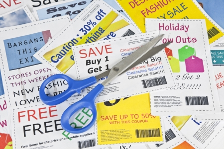 frugal: Completely fake fashion coupons with scissor.  Fictional bar codes.  All coupons were created by the photographer.  No real ads were used.  Photographs in the coupons are the photographers work and are included in the release. Stock Photo