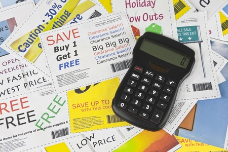 frugal: Completely fake fashion coupons with calculator.  Fictional bar codes.  All coupons were created by the photographer.  No real ads were used.  Photographs in the coupons are the photographers work and are included in the release.