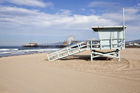 Santa Monica beach, pier and life guard tower in sunny southern California. photo